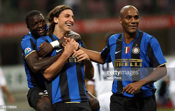 Zlatan Ibrahimovic of Inter Milan celebrates after scoring the first goal with Sulley Muntar and Maicon during the Serie A match between FC Inter...