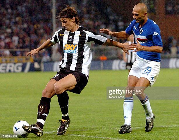 Zlatan Ibrahimovic of Juventus and Giulio Falcone of Sampdoria in action during the Serie A match at Marassi Stadium September 22 2004 in Genova Italy
