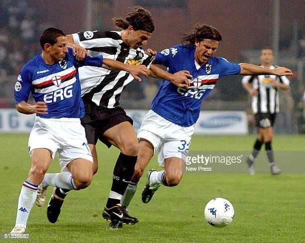 Zlatan Ibrahimovic of Juventus and Simone Pavan of Sampdoria in action during the Serie A match at Marassi Stadium September 22 2004 in Genova Italy