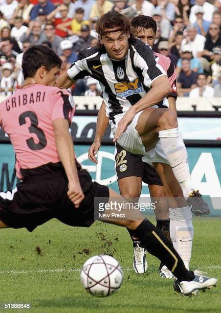 Zlatan Ibrahimovic of Juventus shoots past Cribari of Udinese during the Serie A match played at the Friuli stadium October 3 2004 in Parma Italy