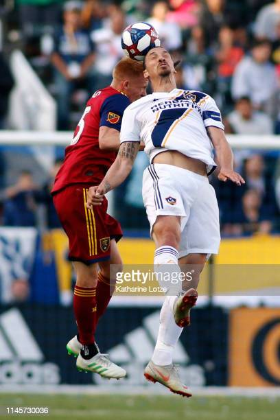 Zlatan Ibrahimovic of Los Angeles Galaxy and Justen Glad of Real Salt Lake go up for a header during the first half of a game at Dignity Health...