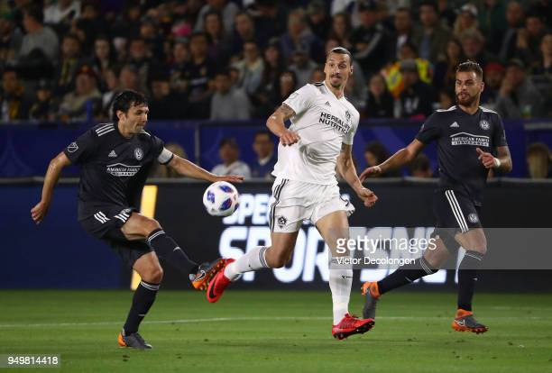 Zlatan Ibrahimovic of Los Angeles Galaxy and Leandro Gonzalez of Atlanta United pursue the play as Michael Parkhurst of Atlanta United plays the...