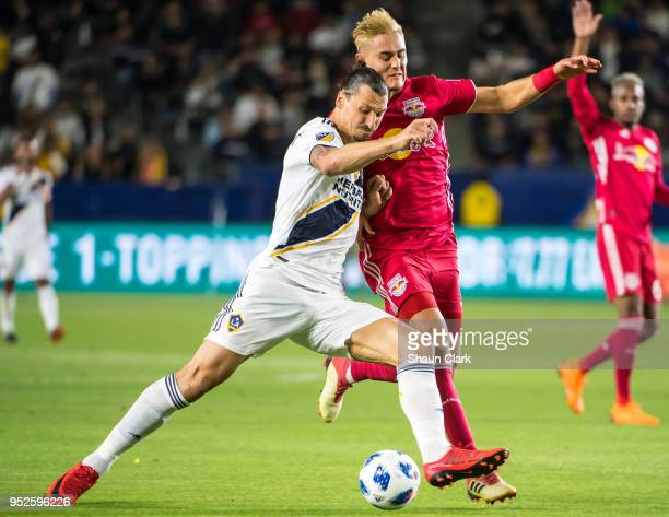 Zlatan Ibrahimovic of Los Angeles Galaxy battles Aaron Long of New York Red Bulls during the Los Angeles Galaxy's MLS match against New York Red...
