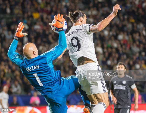 Zlatan Ibrahimovic of Los Angeles Galaxy battles Brad Guzan of Atlanta United during the Los Angeles Galaxy's MLS match against Atlanta United FC at...