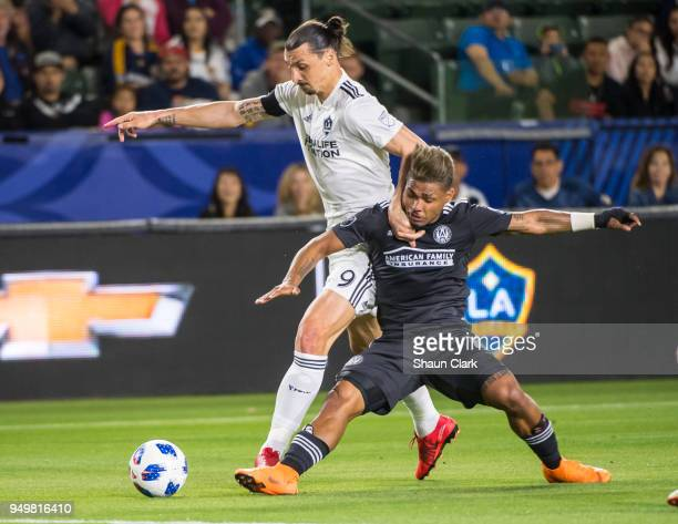 Zlatan Ibrahimovic of Los Angeles Galaxy battles Josef Martinez of Atlanta United during the Los Angeles Galaxy's MLS match against Atlanta United FC...