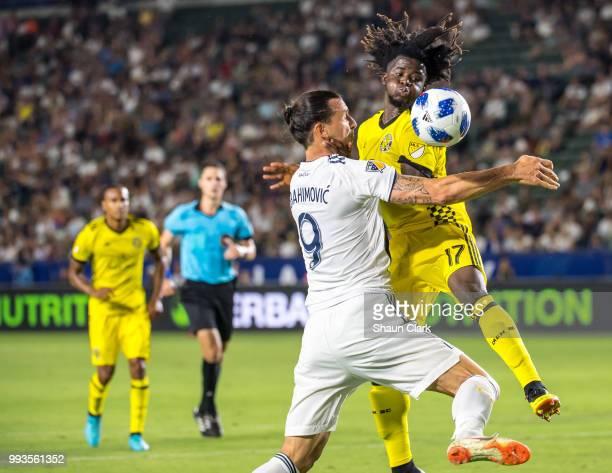 Zlatan Ibrahimovic of Los Angeles Galaxy battles Lalas Abubakar of Columbus Crew during the Los Angeles Galaxy's MLS match against Columbus Crew at...