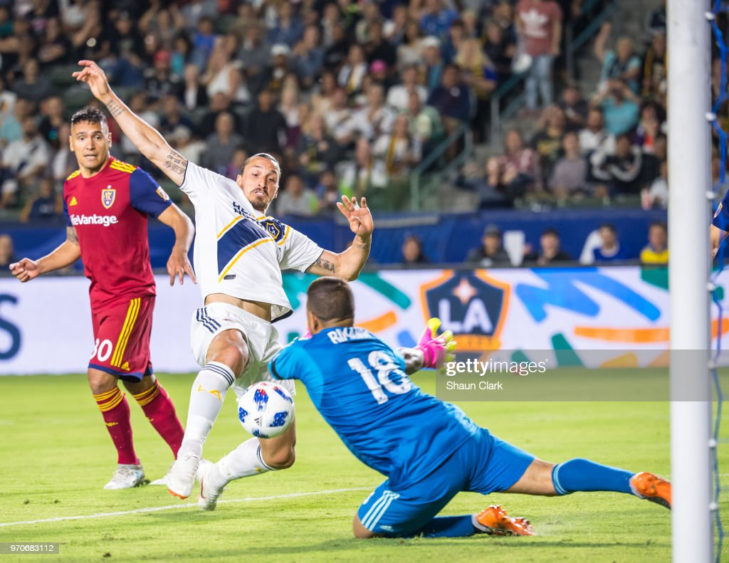 Zlatan Ibrahimovic #9 of Los Angeles Galaxy battles past Nick Rimando #18 of Real Salt Lake during the Los Angeles Galaxy's MLS match against FC Dallas at the StubHub Center on June 9, 2018 in Carson, California. Los Angeles Galaxy won the match 3-0