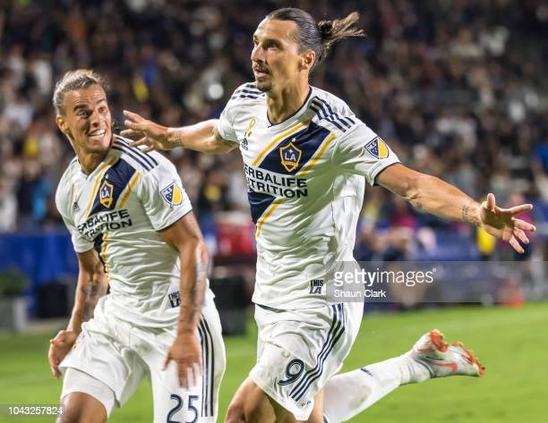 Zlatan Ibrahimovic of Los Angeles Galaxy celebrates his 2nd goal with Rolf Feltscher of Los Angeles Galaxy during the Los Angeles Galaxy's MLS match...