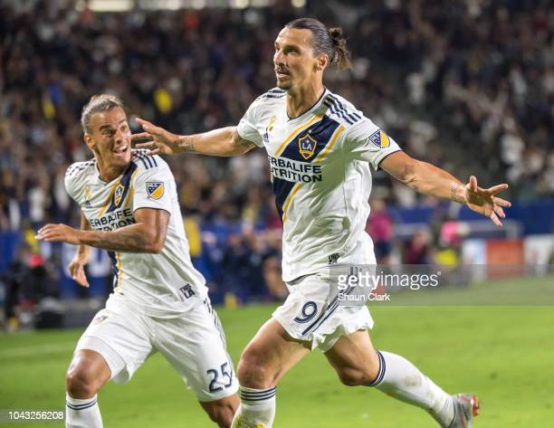 Zlatan Ibrahimovic of Los Angeles Galaxy celebrates his second goal with Rolf Feltscher of Los Angeles Galaxy during the MLS match against Vancouver...