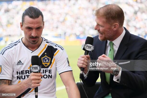 Zlatan Ibrahimovic of Los Angeles Galaxy gets interviewed by Alexi Lalas of Fox Sports after the MLS match between Los Angeles FC and Los Angeles...
