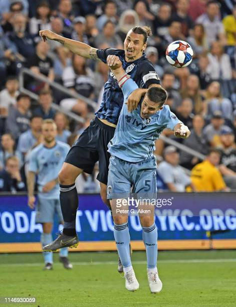 Zlatan Ibrahimovic of Los Angeles Galaxy heads the ball against Matt Besler of Sporting Kansas City during the second half on May 29 2019 at...