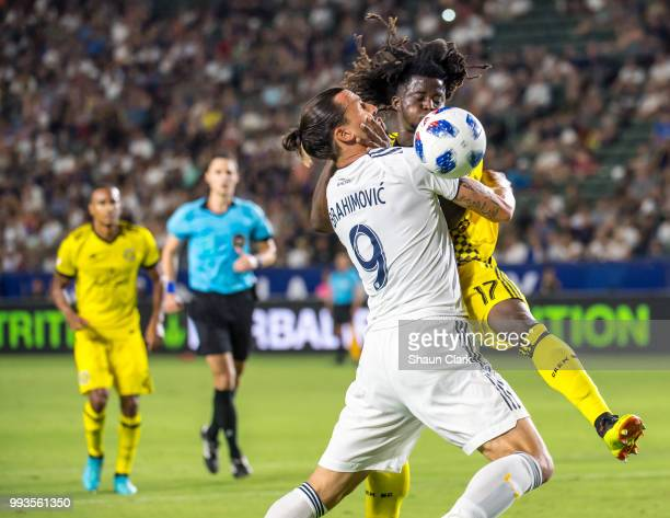 Zlatan Ibrahimovic of Los Angeles Galaxy is fouled by Lalas Abubakar of Columbus Crew during the Los Angeles Galaxy's MLS match against Columbus Crew...