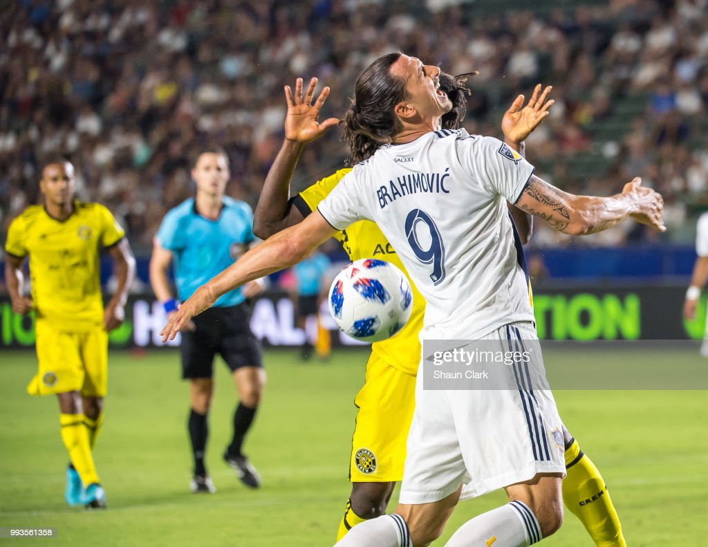Zlatan Ibrahimovic #9 of Los Angeles Galaxy is fouled by Lalas Abubakar #17 of Columbus Crew during the Los Angeles Galaxy's MLS match against Columbus Crew at the StubHub Center on July 7, 2018 in Carson, California. Los Angeles Galaxy won the match 4-0