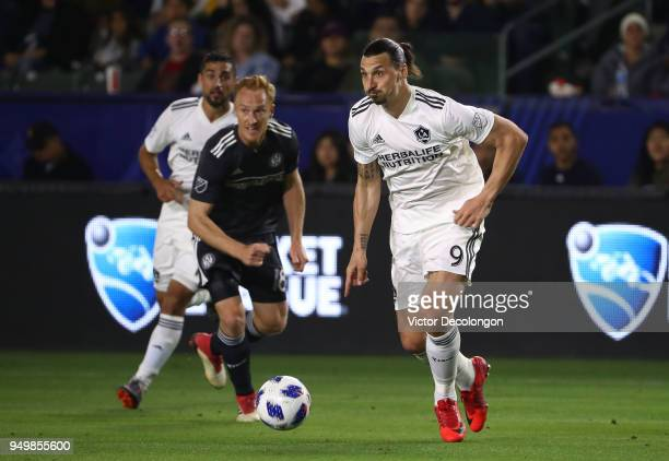 Zlatan Ibrahimovic of Los Angeles Galaxy looks to make a play as Jeff Larentowicz of Atlanta United looks on during the second half of the MLS match...