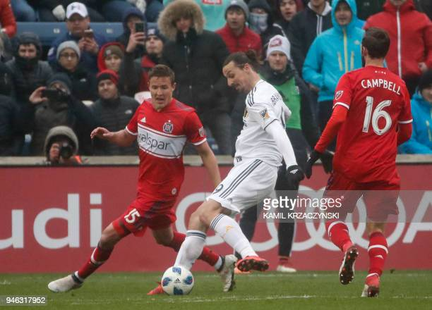 Zlatan Ibrahimovic of Los Angeles Galaxy looks to score against Grant Lillard of Chicago Fire during the second half of a MLS soccer match on April...