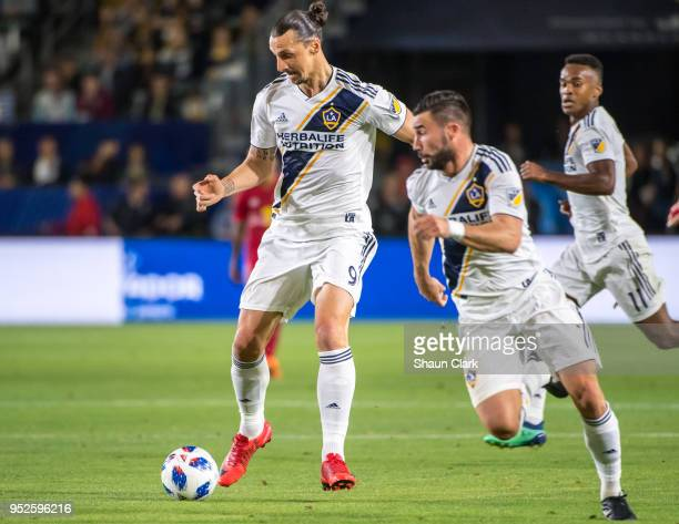 Zlatan Ibrahimovic of Los Angeles Galaxy passes to Romain Alessandrini of Los Angeles Galaxyduring the Los Angeles Galaxy's MLS match against New...