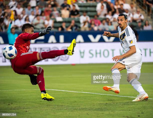 Zlatan Ibrahimovic of Los Angeles Galaxy puts the ball past Zack Steffen of Columbus Crew but it was called offsides during the Los Angeles Galaxy's...