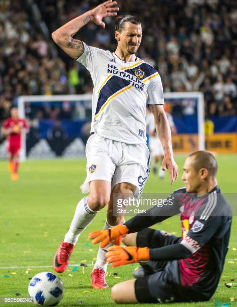 Zlatan Ibrahimovic of Los Angeles Galaxy reacts as Luis Robles of New York Red Bulls grabs the ball during the Los Angeles Galaxy's MLS match against...