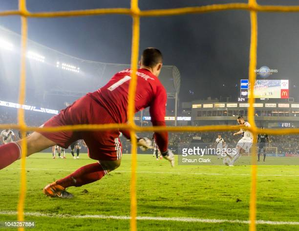 Zlatan Ibrahimovic of Los Angeles Galaxy scores a penalty kick during the Los Angeles Galaxy's MLS match against Vancouver Whitecaps at the StubHub...