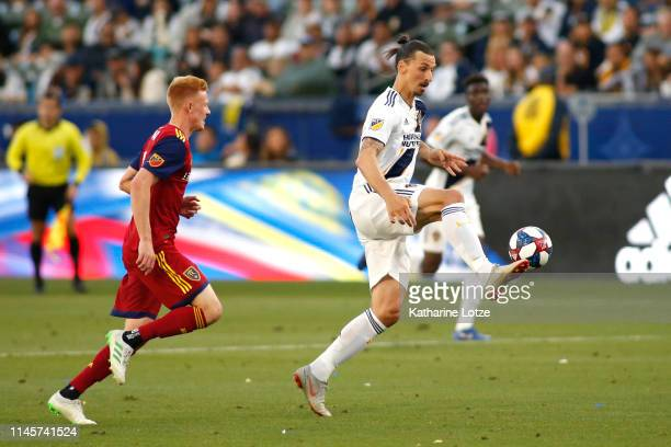 Zlatan Ibrahimovic of Los Angeles Galaxy settles the ball as Justen Glad of Real Salt Lake follows during the second half of a game at Dignity Health...