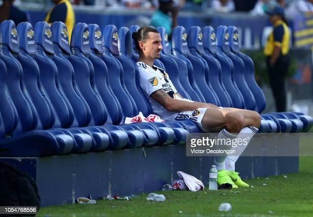 Zlatan Ibrahimovic of Los Angeles Galaxy sits alone on the bench after their 32 loss to the Houston Dynamo in their MLS match at StubHub Center on...