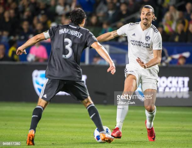 Zlatan Ibrahimovic of Los Angeles Galaxy takes on Michael Parkhurst of Atlanta United during the Los Angeles Galaxy's MLS match against Atlanta...