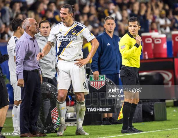 Zlatan Ibrahimovic of Los Angeles Galaxy talks to head coach Dominic Kinnear during the Los Angeles Galaxy's MLS match against Vancouver Whitecaps at...