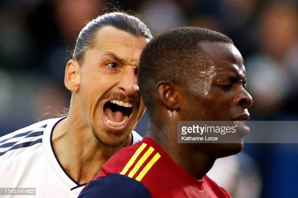 Zlatan Ibrahimovic of Los Angeles Galaxy yells at Nedum Onuoha of Real Salt Lake after scoring a goal during the second half of a game at Dignity...