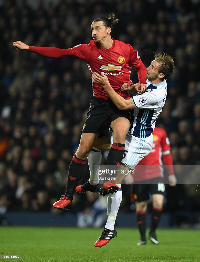 Zlatan Ibrahimovic of Manchester United (L) and Craig Dawson of West Bromwich Albion (R) clash during the Premier League match between West Bromwich Albion and Manchester United at The Hawthorns on December 17, 2016 in West Bromwich, England.