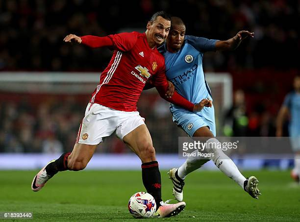 Zlatan Ibrahimovic of Manchester United and Fernando of Manchester City battle for possession during the EFL Cup fourth round match between...