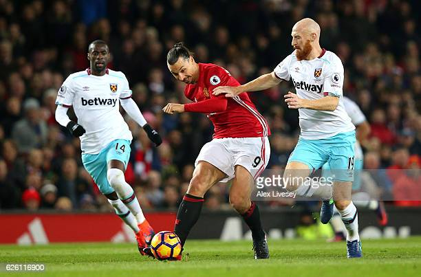 Zlatan Ibrahimovic of Manchester United and James Collins of West Ham United battle for possession during the Premier League match between Manchester...