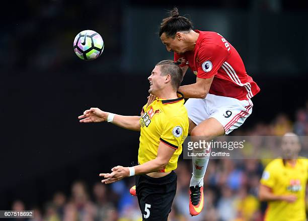 Zlatan Ibrahimovic of Manchester United and Sebastian Prodl of Watford battle for possession in the air during the Premier League match between...