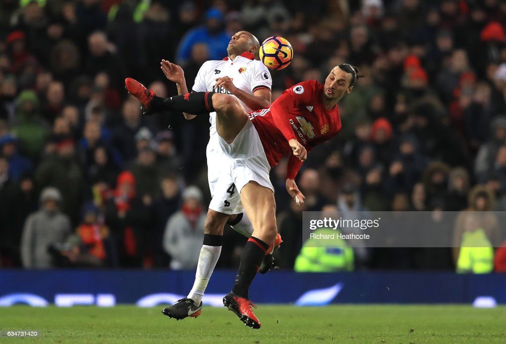 Zlatan Ibrahimovic of Manchester United and Younes Kaboul of Watford compete for the ball during the Premier League match between Manchester United and Watford at Old Trafford on February 11, 2017 in Manchester, England.