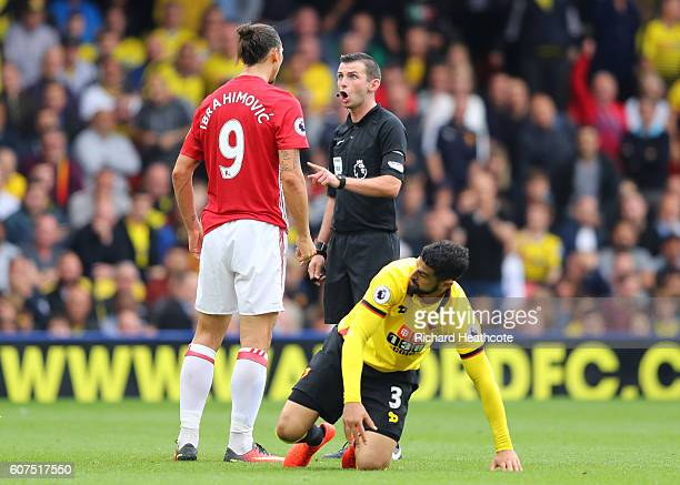 Zlatan Ibrahimovic of Manchester United argues with referee Michael Oliver during the Premier League match between Watford and Manchester United at...