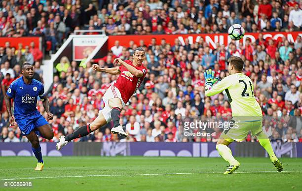Zlatan Ibrahimovic of Manchester United attempts to volley the ball past RonRobert Zieler of Leicester City during the Premier League match between...