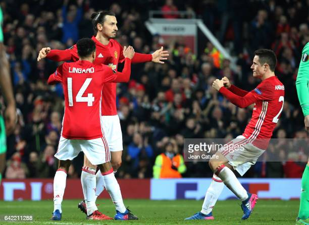 Zlatan Ibrahimovic of Manchester United celebrates his second goal with Jesse Lingard and Ander Herrera during the UEFA Europa League Round of 32...