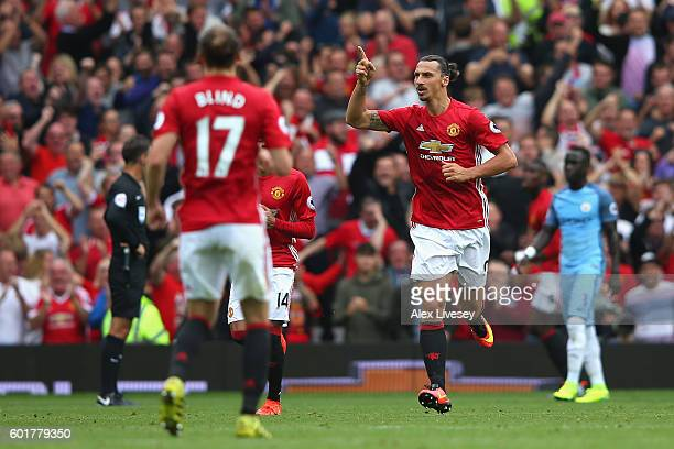 Zlatan Ibrahimovic of Manchester United celebrates scoring his sides first goal during the Premier League match between Manchester United and...