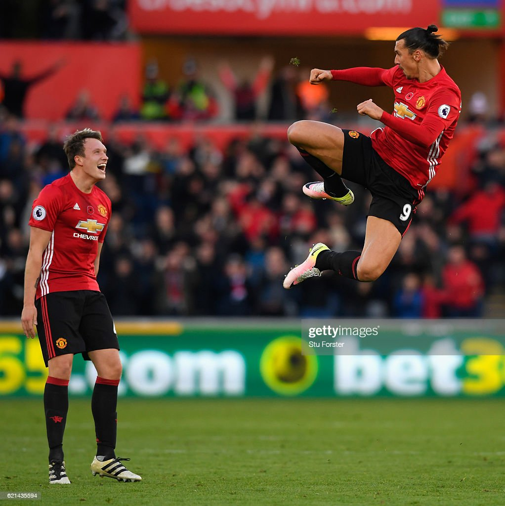 Zlatan Ibrahimovic of Manchester United celebrates scoring his sides second goal with Phil Jones (l) during the Premier League match between Swansea City and Manchester United at Liberty Stadium on November 6, 2016 in Swansea, Wales.