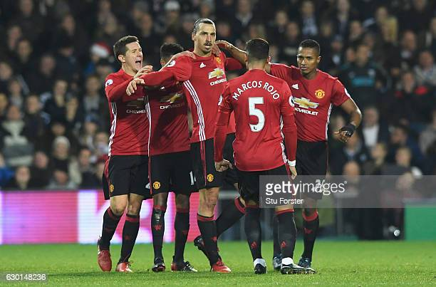 Zlatan Ibrahimovic of Manchester United celebrates scoring his sides second goal with his Manchester United team mates during the Premier League...