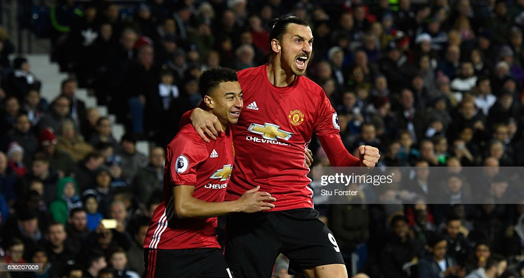 Zlatan Ibrahimovic of Manchester United (R) celebrates scoring his sides first goal with Jesse Lingard of Manchester United (L) during the Premier League match between West Bromwich Albion and Manchester United at The Hawthorns on December 17, 2016 in West Bromwich, England.