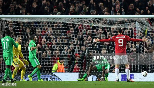 Zlatan Ibrahimovic of Manchester United celebrates scoring his sides second goal during the UEFA Europa League Round of 32 first leg match between...