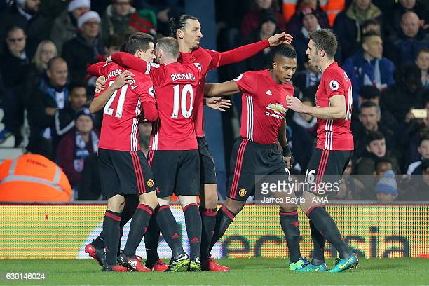 Zlatan Ibrahimovic of Manchester United celebrates scoring the first goal with his team-mates to make the score 0-1 during the Premier League match...