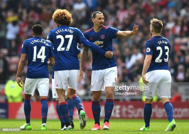 Zlatan Ibrahimovic of Manchester United celebrates scoring the opening goal with team mates during the Premier League match between Sunderland and...