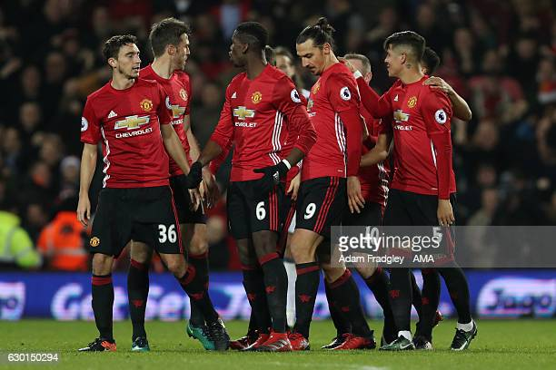 Zlatan Ibrahimovic of Manchester United celebrates scoring the second goal with his teammates to make the score 02 during the Premier League match...