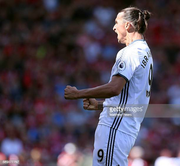 Zlatan Ibrahimovic of Manchester United celebrates scoring the third goal to make the score 03 during the Premier League match between AFC...