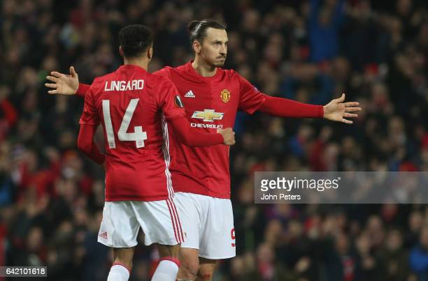 Zlatan Ibrahimovic of Manchester United celebrates scoring their second goal during the UEFA Europa League Round of 32 first leg match between...