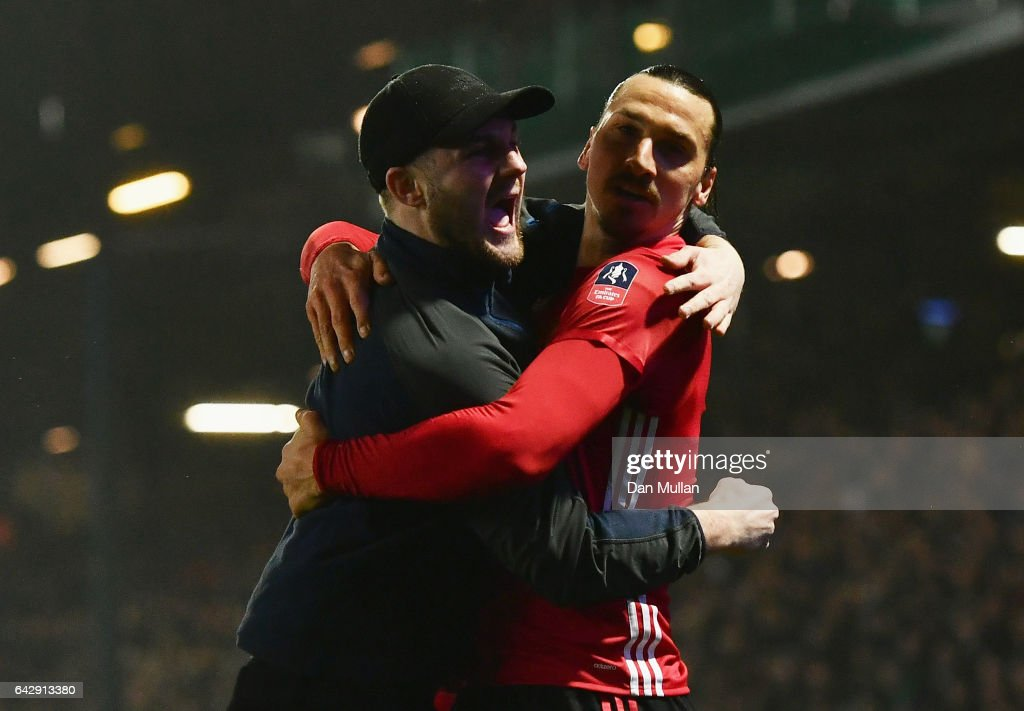 Zlatan Ibrahimovic of Manchester United (9) celebrates with a fans as he runs onto the pitch as he scores their second goal during The Emirates FA Cup Fifth Round match between Blackburn Rovers and Manchester United at Ewood Park on February 19, 2017 in Blackburn, England.
