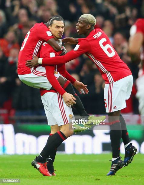Zlatan Ibrahimovic of Manchester United celebrates with Eric Bailly and Paul Pogba as he scores their first goal during the EFL Cup Final match...