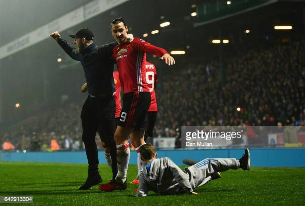 Zlatan Ibrahimovic of Manchester United celebrates with fans as they run onto the pitch as he scores their second goal during The Emirates FA Cup...