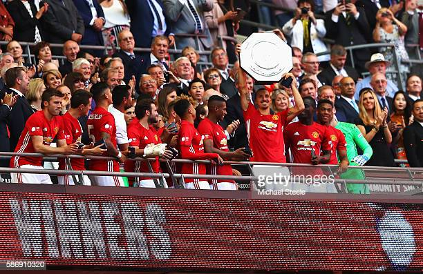 Zlatan Ibrahimovic of Manchester United celebrates with his team mates after he lifts the Community Shield during The FA Community Shield match...